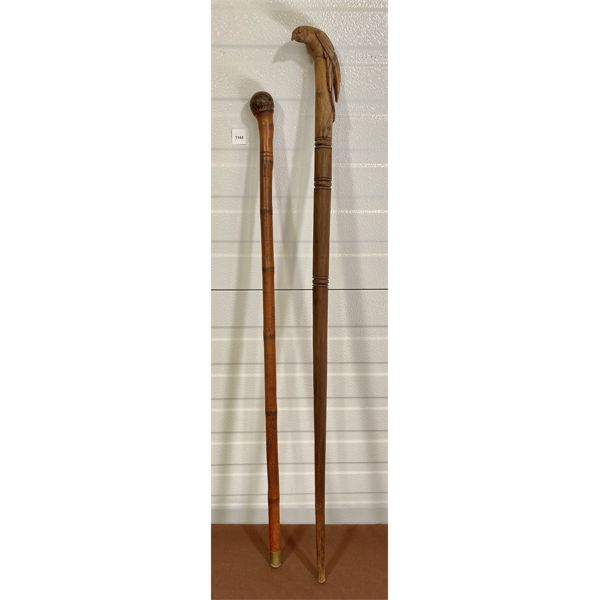LOT OF 2 - DECORATIVE HAND CARVED CANES - APPROX 36 INCHES