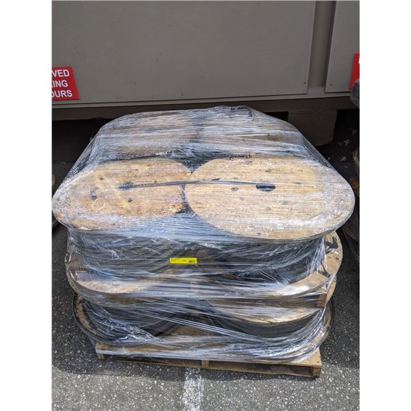 Pallet of 8 large rolls of 1/2 in. braided steel cable line popular sci-fi tv series