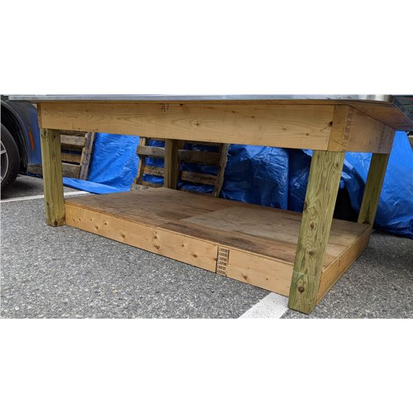 Wooden base table w/ approx 6 1/2 ft by 5ft  stainless steel top from the popular sci-fi tv series