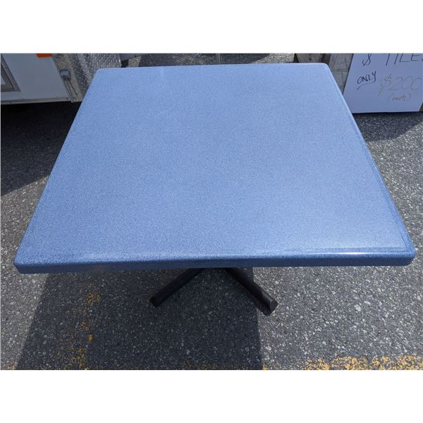 Heavy black metal base square table w/ blue fibre glass table top approx 3 1/2 ft by 3 1/2 from the