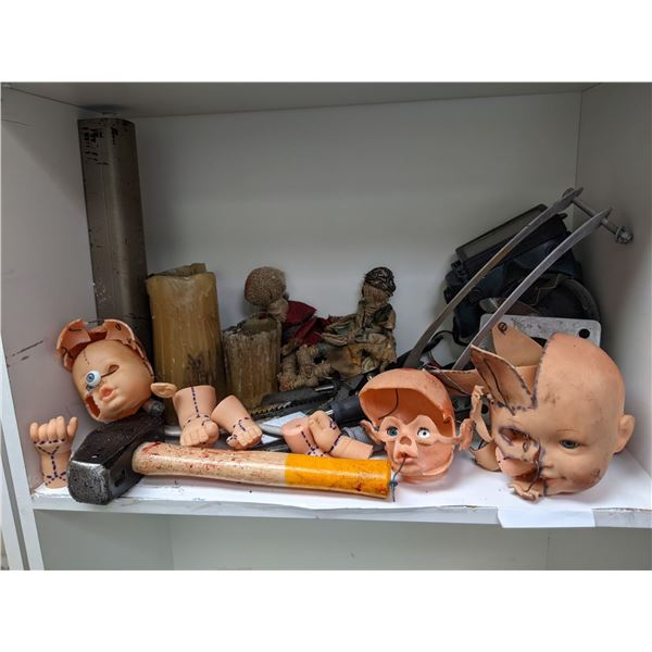 Shelf lot of small assorted props, baby doll parts, sledge hammer, saws, pruners from the popular sc