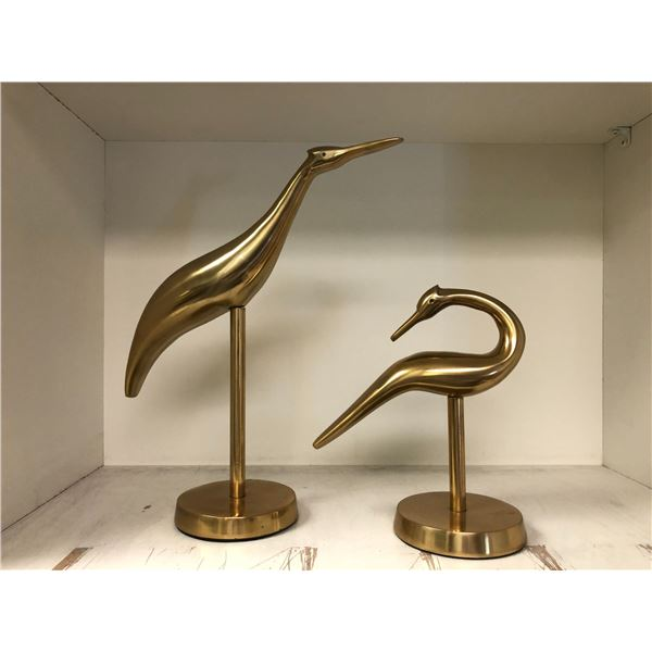 Two brass bird ornaments from the sci-fi show