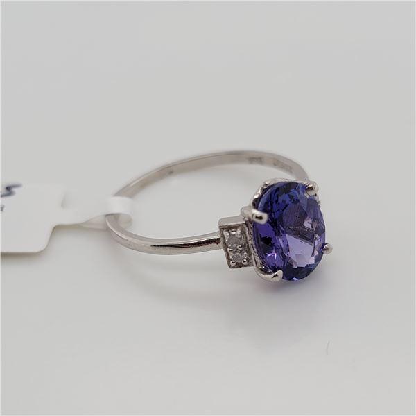BZ337-23 PLATINUM TANZANITE  DIAMOND RING
