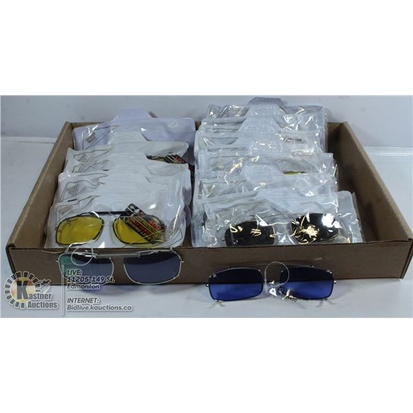 FLAT OF CLIP ON SUNGLASSES COVERS.