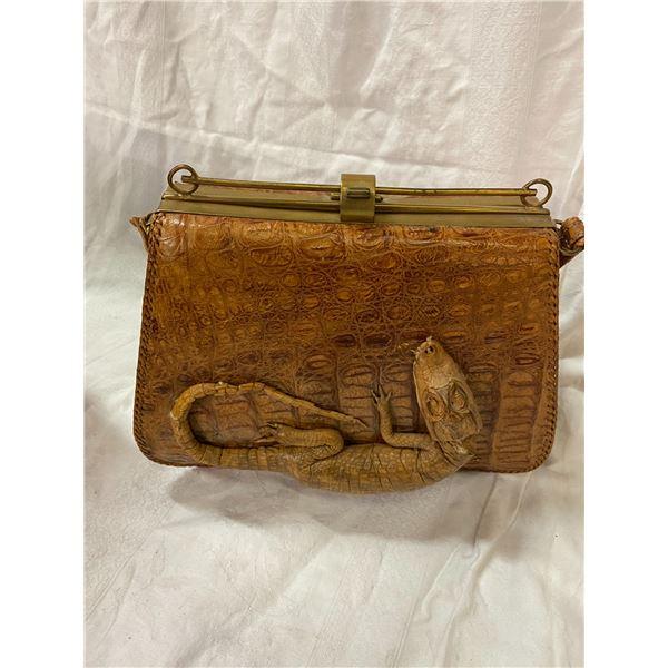 Alligator skin purse handle needs repair