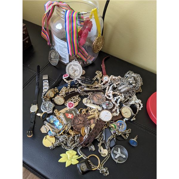 jar of treasures assorted medals, pins, jewelry