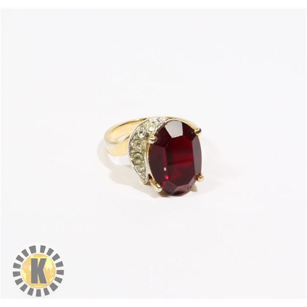 925-112 GOLD TONE BAND W/ LARGE RED JEWEL & CRYSTALS ON