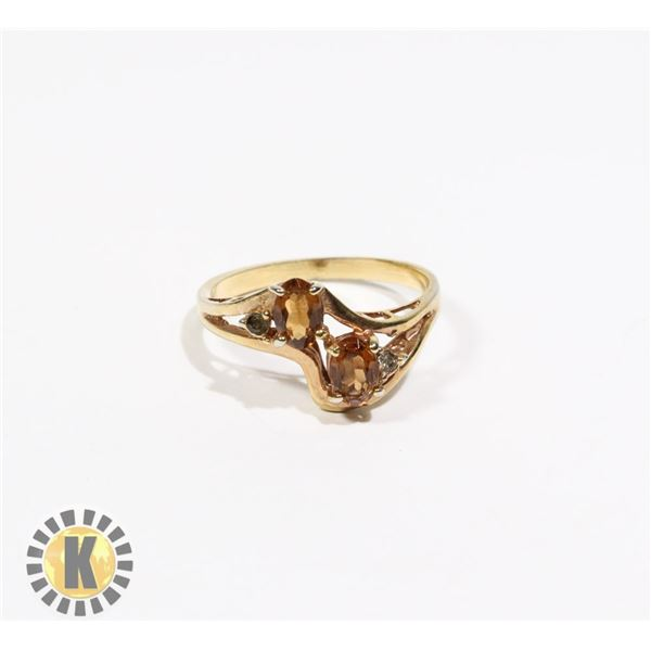 925-143 GOLD TONE BAND W/ 2 BROWN JEWELS RING