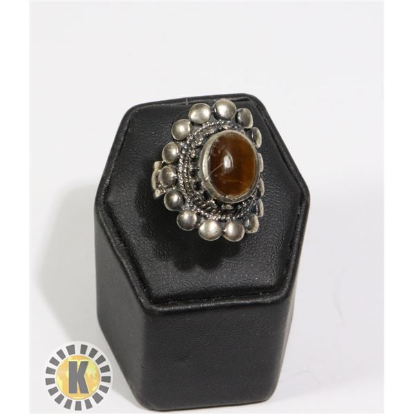 925-140 LARGE CIRCLE SHAPED WITH BROWN JEWEL
