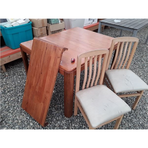 Kitchen table with leaf and two chairs