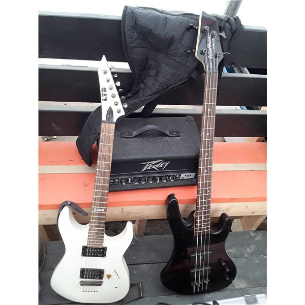 two guitars and peavey amp