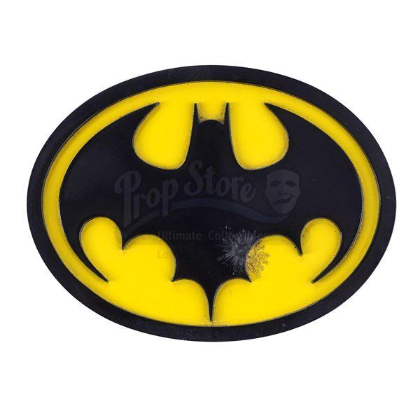 Lot # 32: BATMAN (1989) - Batman's (Michael Keaton) Screen-Matched Bullet-Hit Chest Emblem