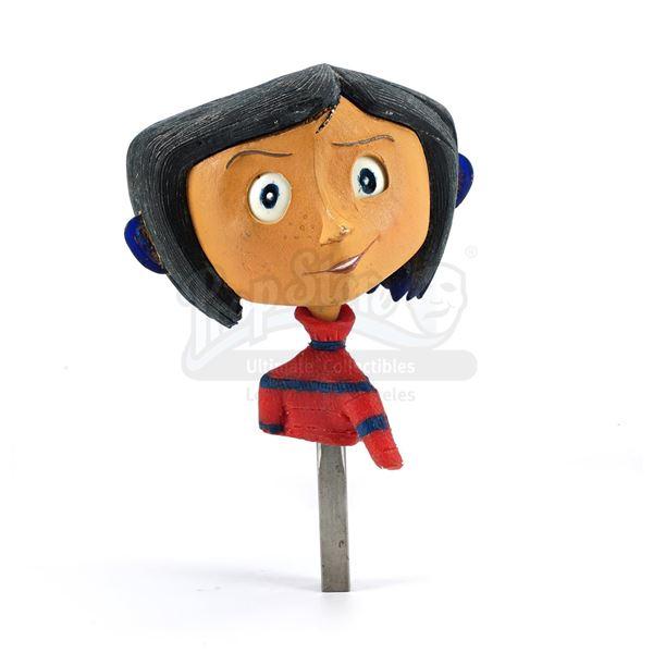 Lot # 54: CORALINE (2009) - First-Ever Prototype Coraline Jones (Dakota Fanning) Puppet Built for th