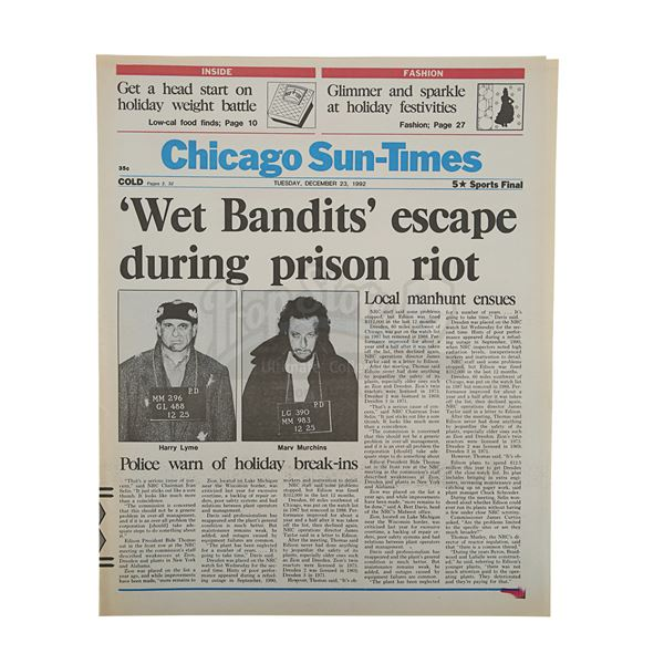 """Lot # 116: HOME ALONE 2: LOST IN NEW YORK (1992) - """"Wet Bandits Escape"""" Newspaper"""