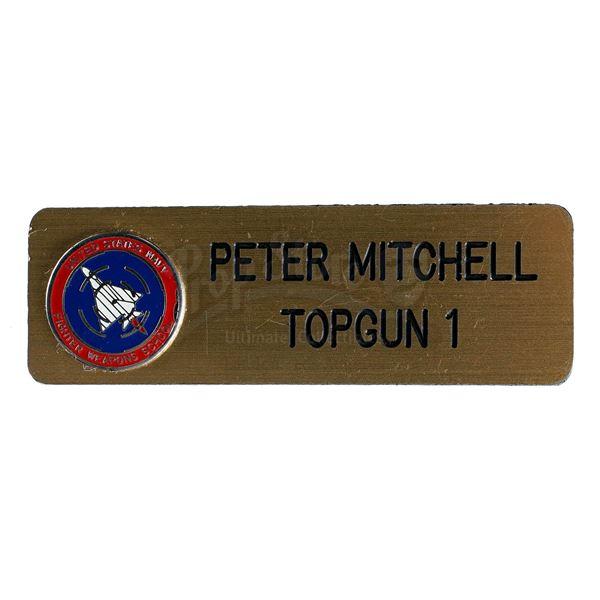 "Lot # 387: TOP GUN (1986) - Pete ""Maverick"" Mitchell's (Tom Cruise) Uniform Nameplate"