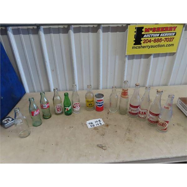 Approx 14 Old Pop Bottles- Wyola w Caos, KIK, Scona & 7 UP Plus