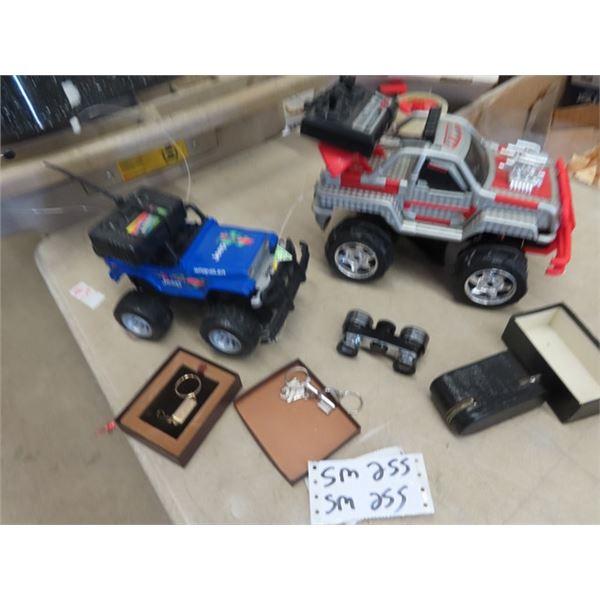 2 Remote Control Trucks, Key Chain, & Binoculars