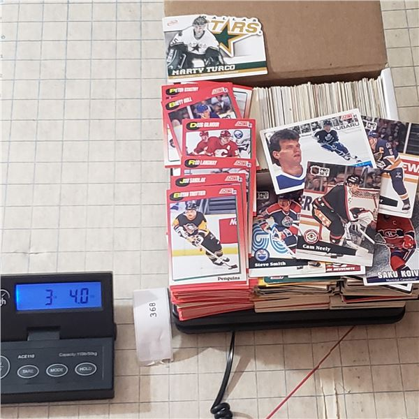 3.25 pounds of early 90s hockey trading cards (including box) there is enough to fill the box twice
