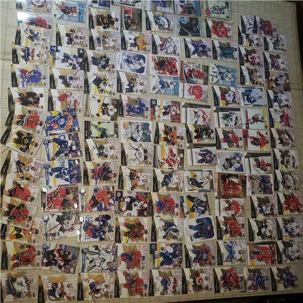 100+ mostly Modern hockey cards, early Mike Bossy (centred!!), numbered Autograph Karlson, numbered