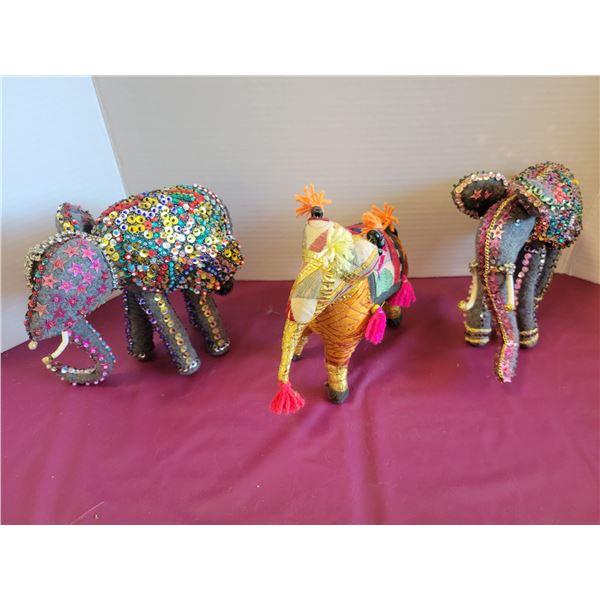 3 decorated cloth elephants