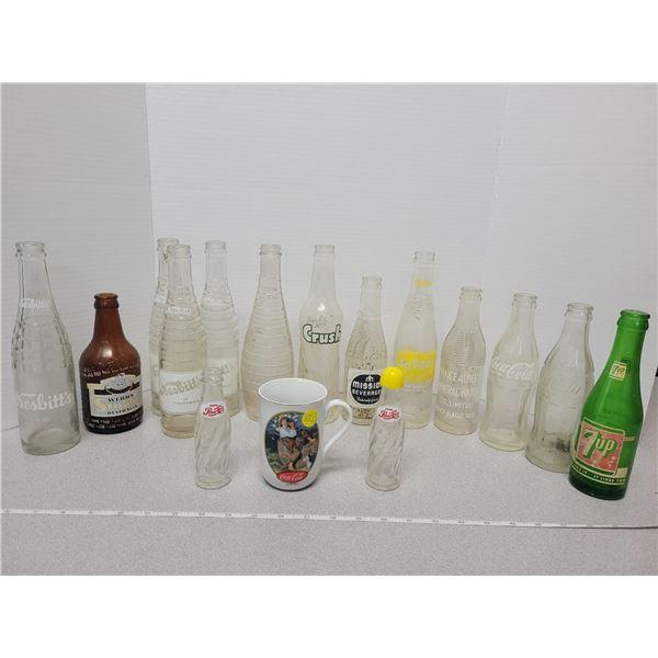 13 bottles, 1 Norman Rockwell coke mug, Salt & Pepper shaker set