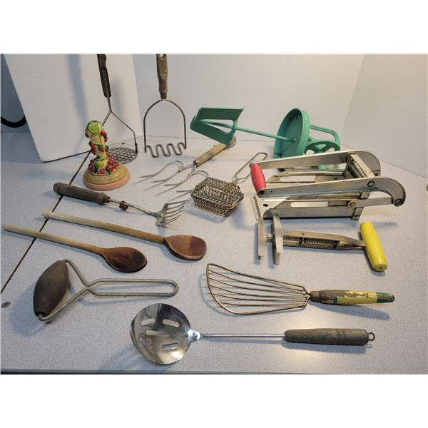 Vintage kitchen utensils including butter press and potato chipper