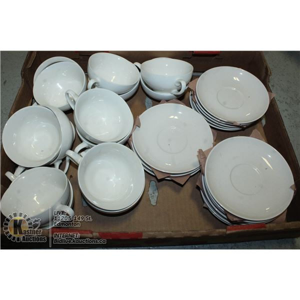 FLAT OF WHITE TEACUPS AND SAUCERS