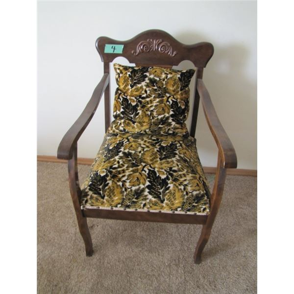 wood frame armchair most likely has been refinished