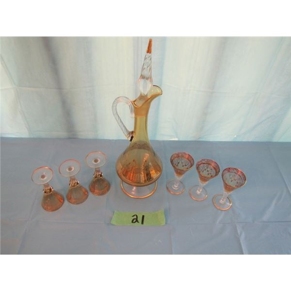 amber coloured decanter with gold relief comes with six glasses