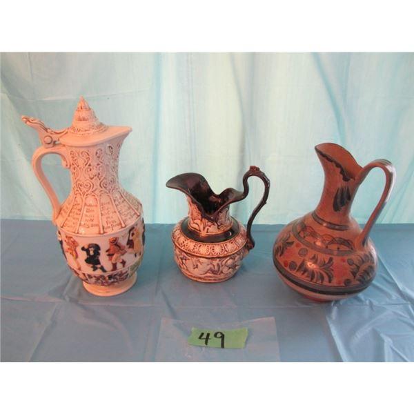 lot with three ceramic pitchers