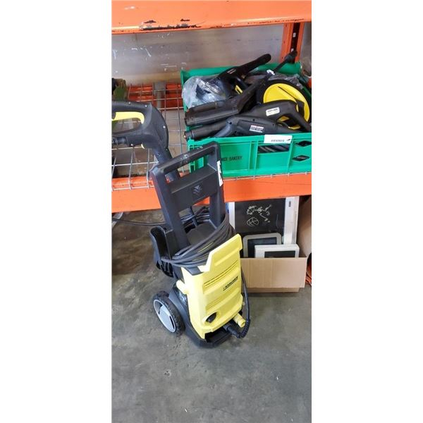 Karcher electric pressure washer with tray of new and used karcher parts