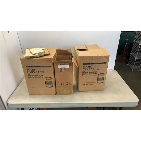 Canning machine and 2 boxes of canning cans and lids