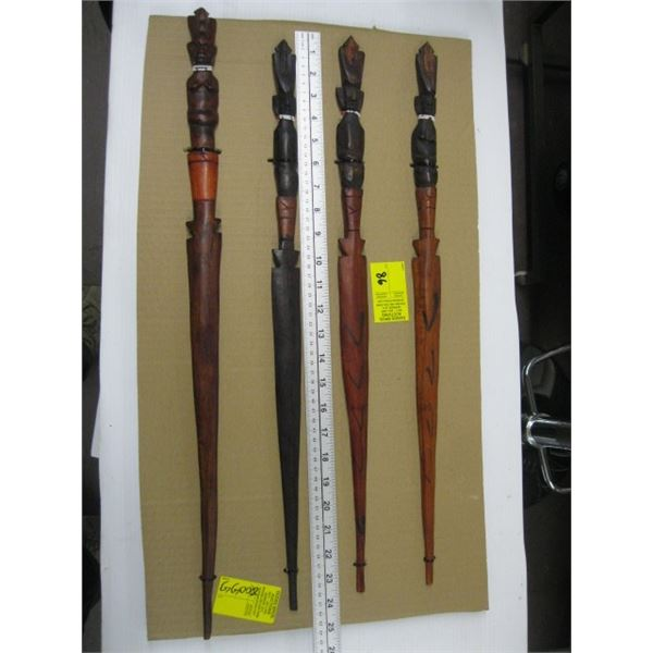 BOARD OF 4 DECORATIVE CARVED WOODEN SPEARS