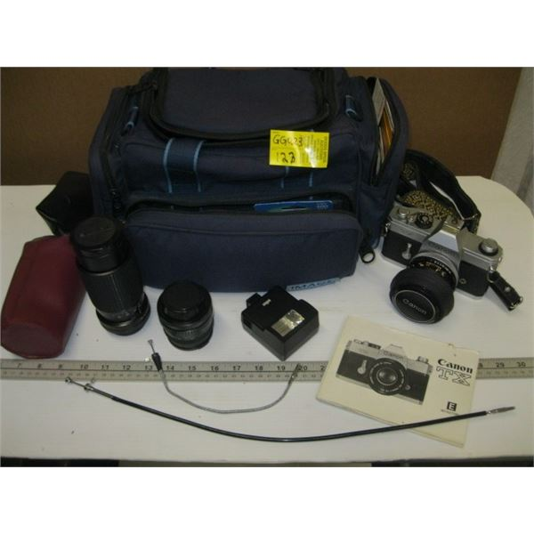 CANON TX 35MM CAMERA WITH EXTRA LENS, FLASH, BAG & ACCESS.