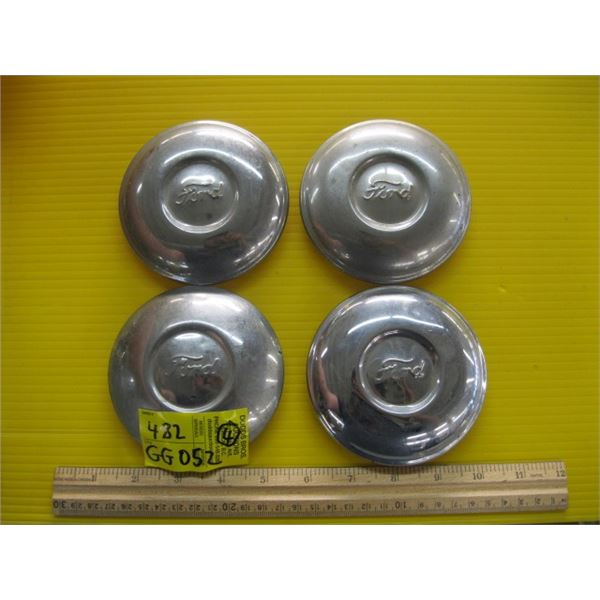 4 FORD HUBCAPS, 3 OF THE SAME, 1 SLIGHTLY DIFFERENT