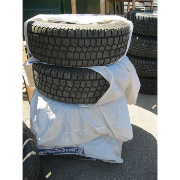 SET OF 4 27565R18 MUD AND SNOW TIRES