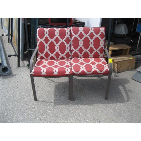 2 PATIO CHAIRS WITH RED CUSHIONS,MISSING ARM ON EACH, USED AS LOVESEAT