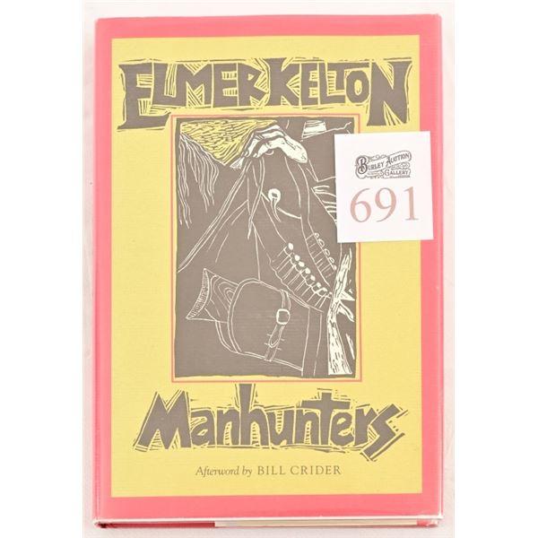 """Manhunters"" by Elmer Kelton"
