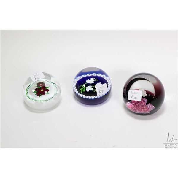 """Three collectible Scottish Caithness Glass paperweights including limited edition """"Flight"""" 454/750,"""
