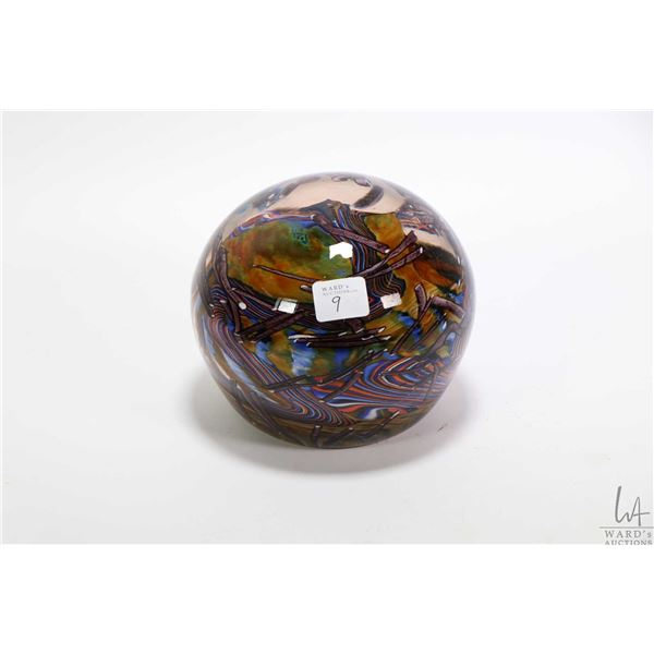 """Large glass paperweight 6"""" in diameter and 5"""" in height with artist initials J.V."""