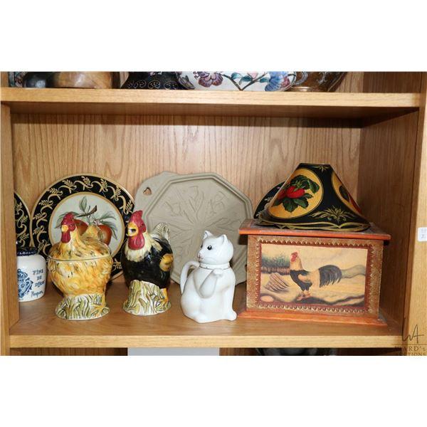 Shelf lot of decor items including four handpainted plates, Fitz & Floyd fruit motif spooner, chicke