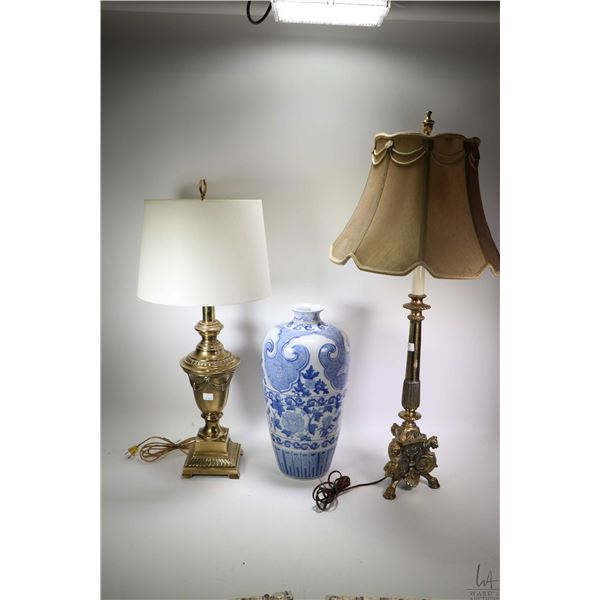 """Two brass table lamps with shades and a 18"""" blue and white glazed pottery vase"""