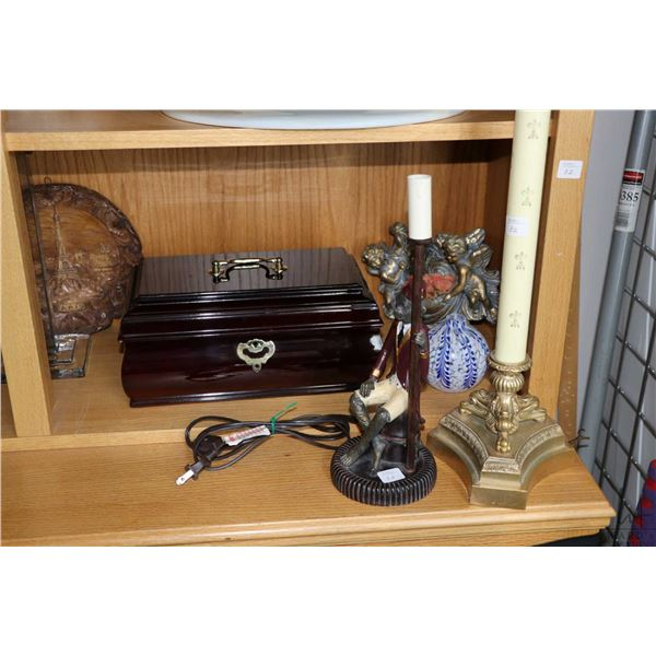 Shelf lot of decor items including cast metal monkey motif table lamp, wooden tea chest style box, c