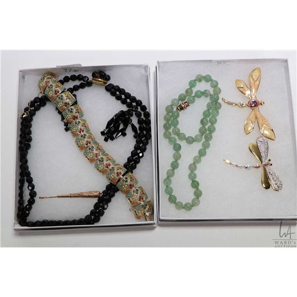 Two trays of vintage collectible jewellery including jade like beaded necklace, two gold toned and d