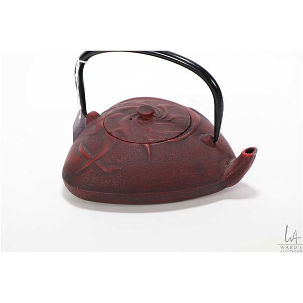 Japanese red cast iron teapot with tea infuser