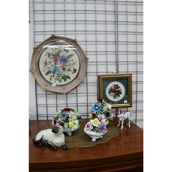 """Two framed floral motif needleworks, a 8"""" Beswick cat figure, small glazed porcelain burro plus thre"""