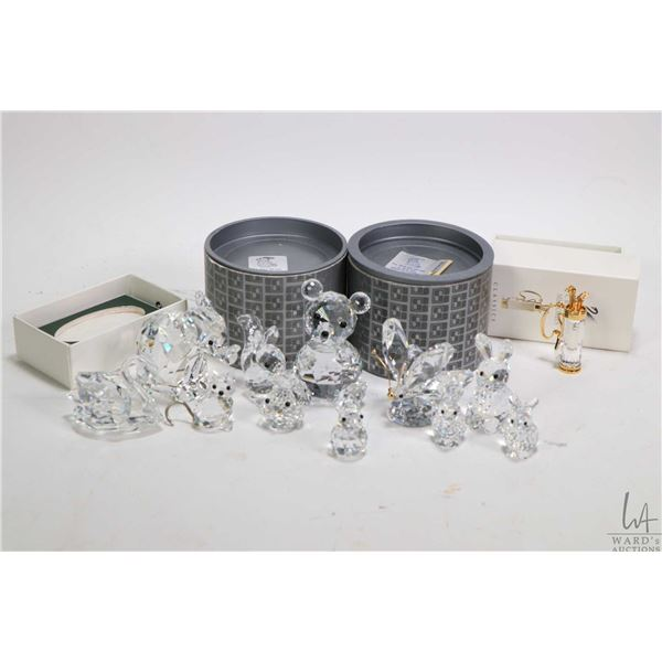 Twelve Swarovski crystal collectibles including elephant, teddy bear, butterfly, swan, small cat and