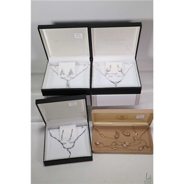 Four boxes suites of jewellery including three Fifth Avenue necklace and earring set plus a Monet  g