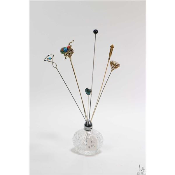 Selection of vintage and antique hat pins including a sterling silver set with turquoise, a cloisson