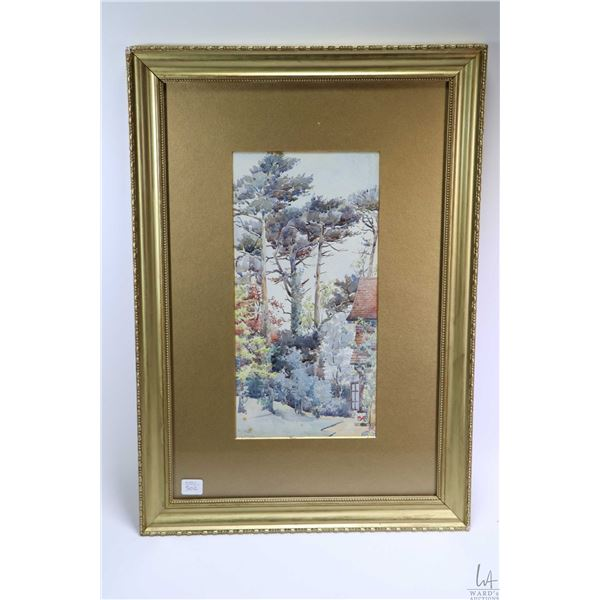 Gilt framed watercolour painting of a English treed garden scene signed by artist E.M.T and labelled